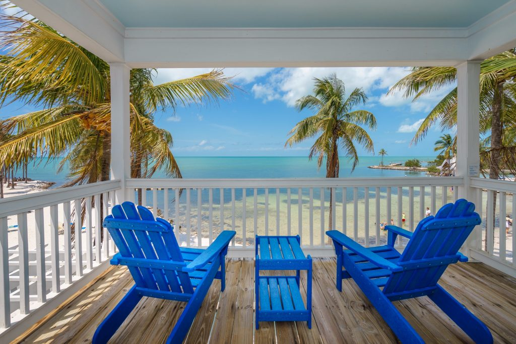 Beach house balcony overlooking private beach at Tranquility Bay Resort, Florida Keys