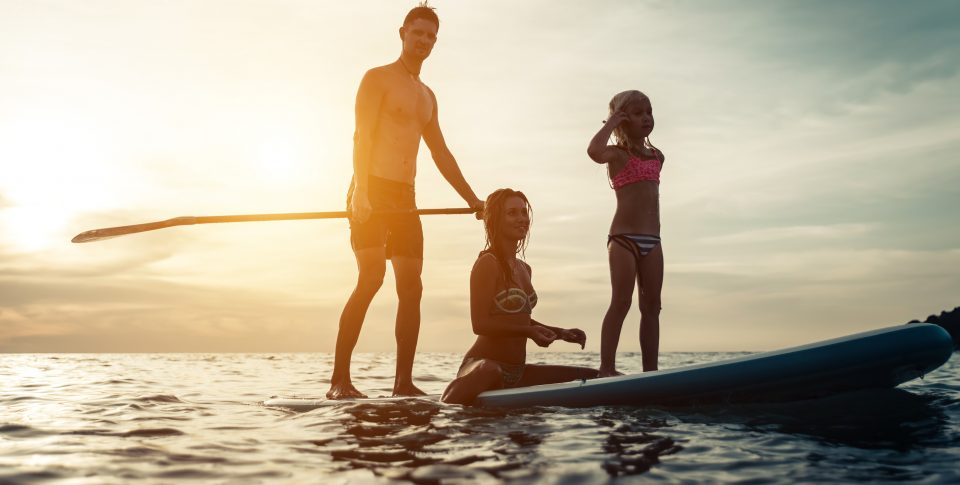 Dad and family on a paddle board in the Florida Keys