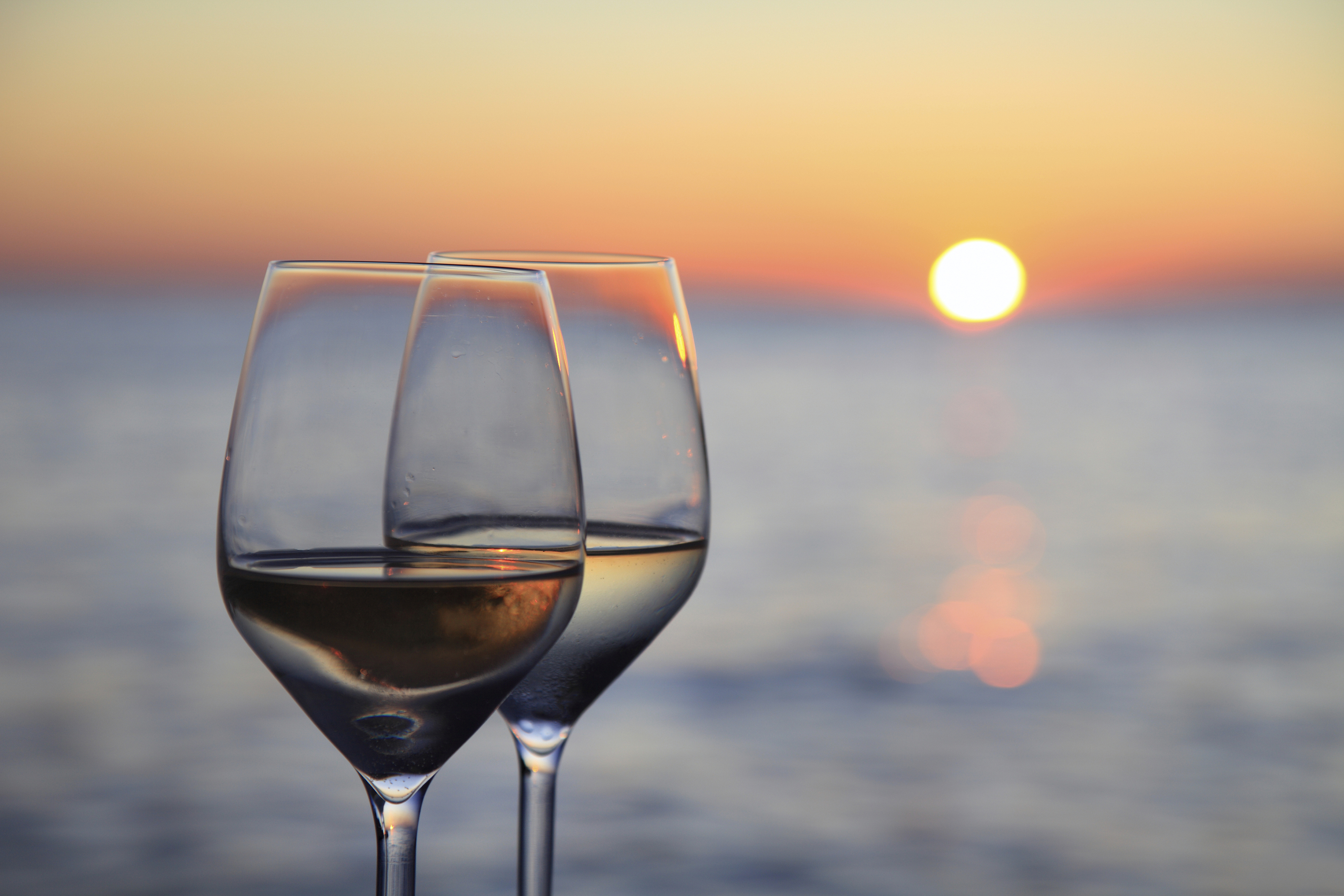Glass of wine in front of a stunning Florida Keys sunset