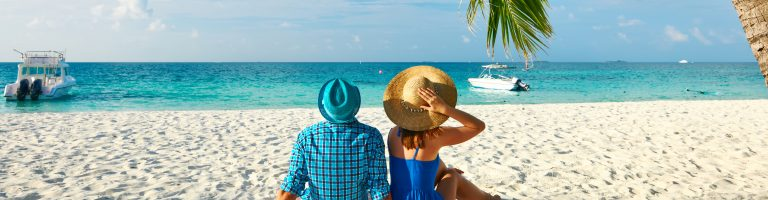 Couple in blue clothes on a beach in Marathon, Florida