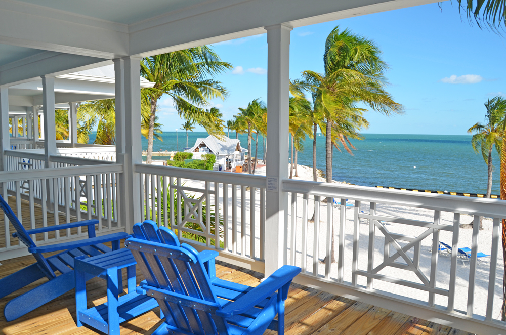 Beach house balcony overlooking Tranquility Bay's private beach