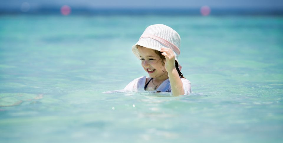 Young girl playing in the crystal clear waters surrounding the Florida Keys