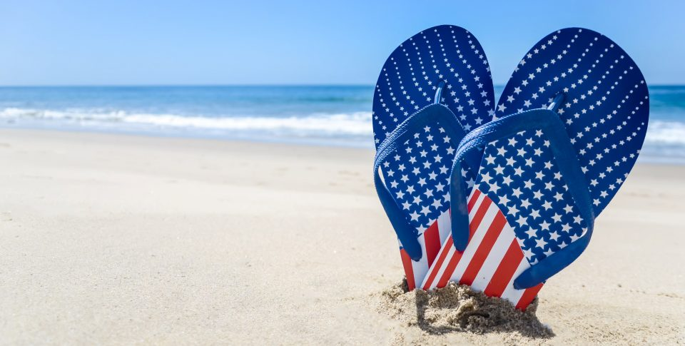 Patriotic USA sandals on a sandy beach in the Florida Keys