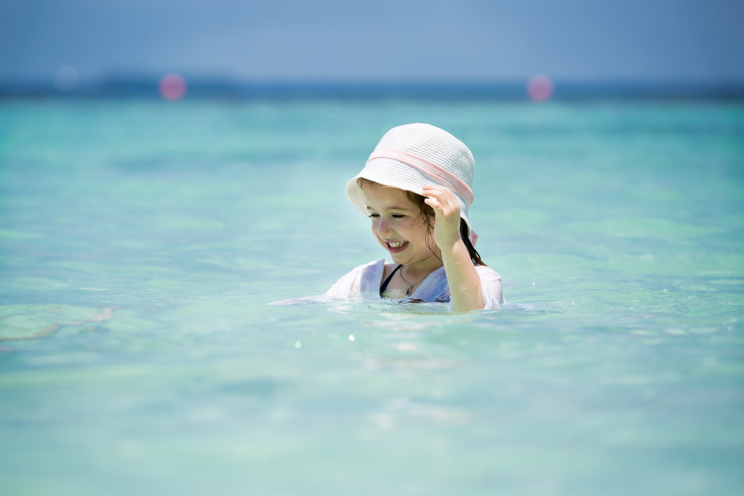 Little girl swimming in crystal clear waters in the Florida Keys