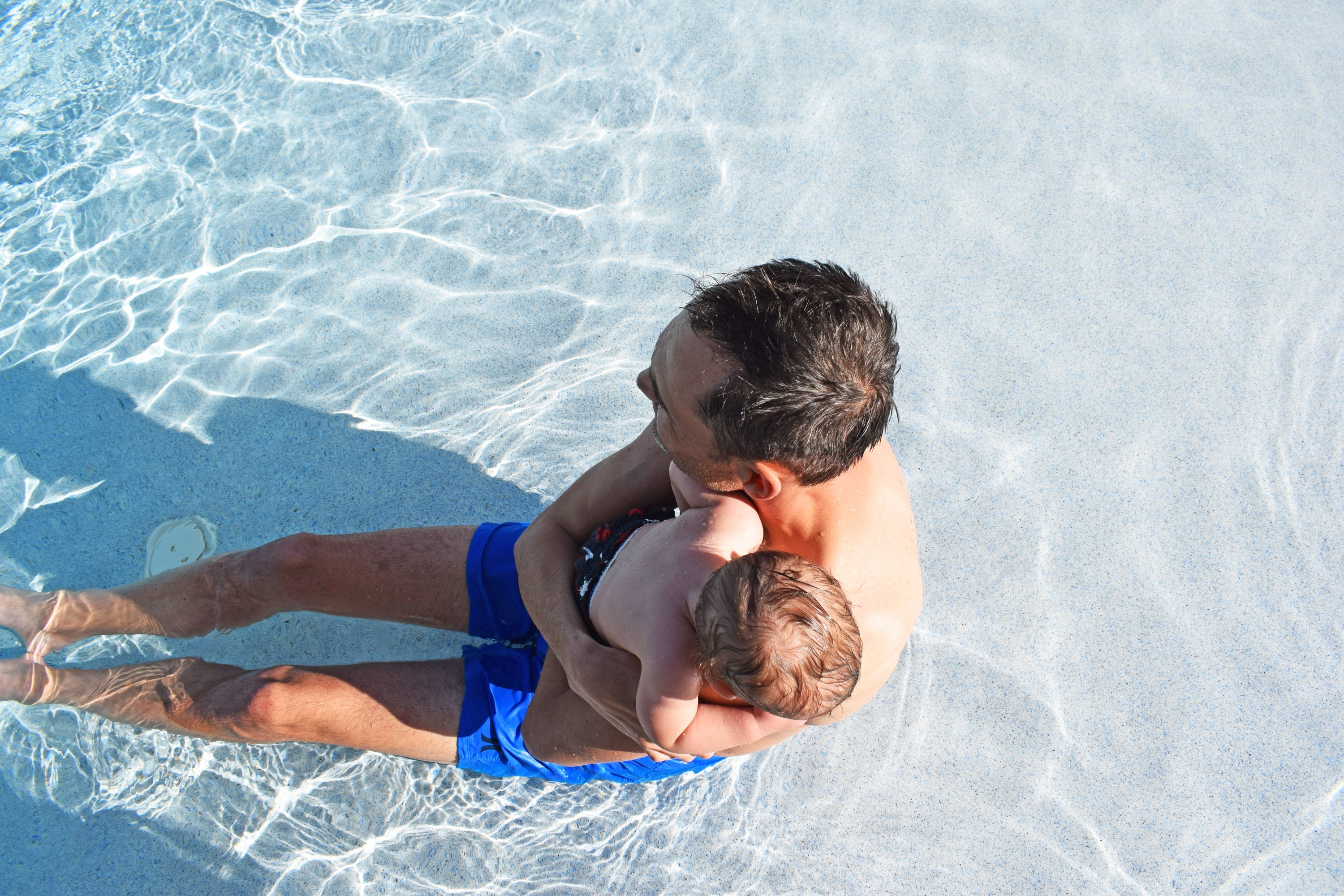 Father and son in swimming pool in the Florida Keys