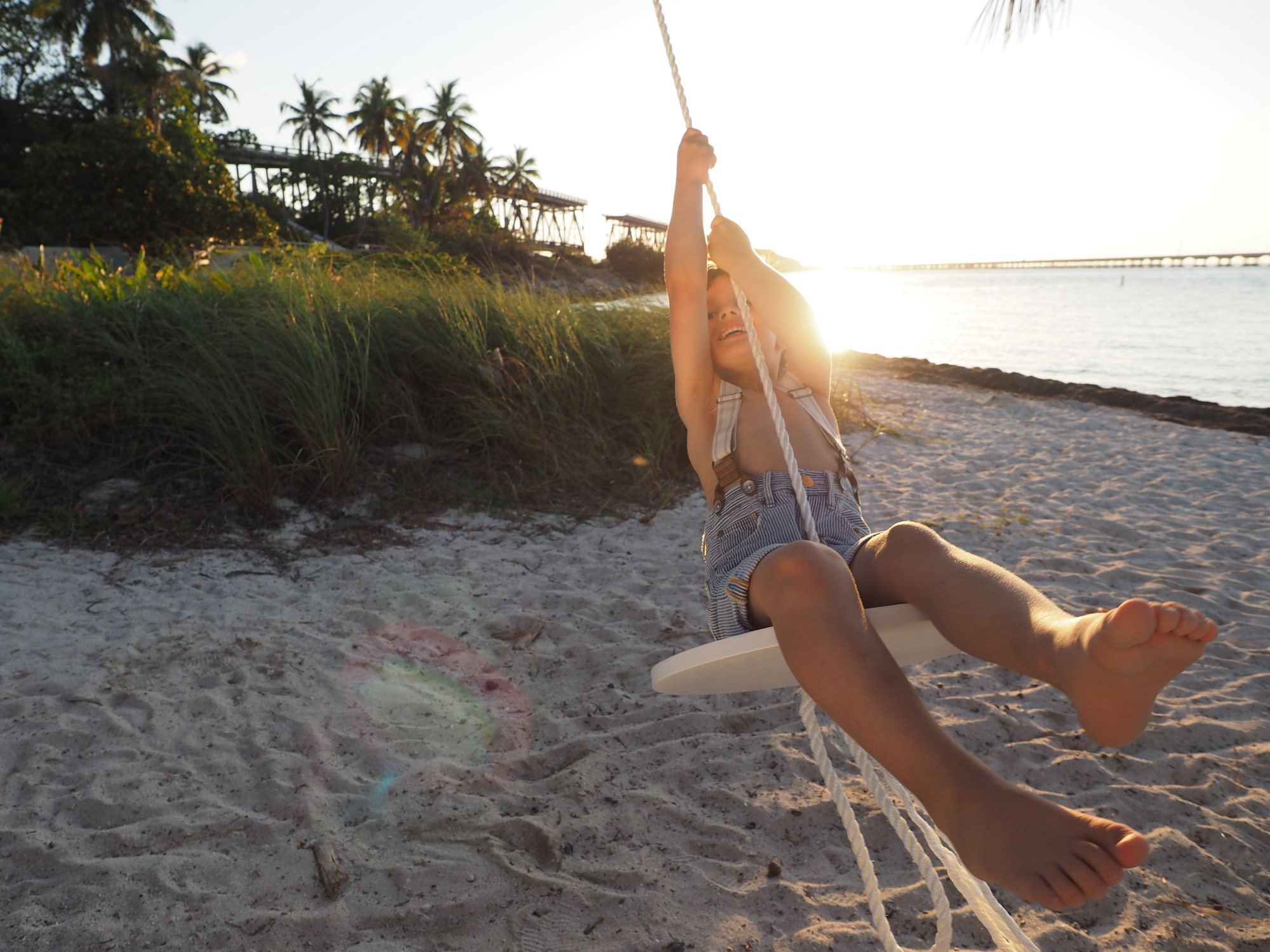 Child on swing on beach in the Florida Keys