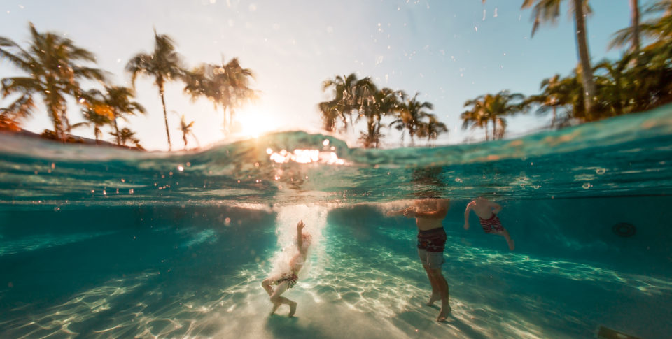 Family swimming at Tranquility Bay in the Florida Keys